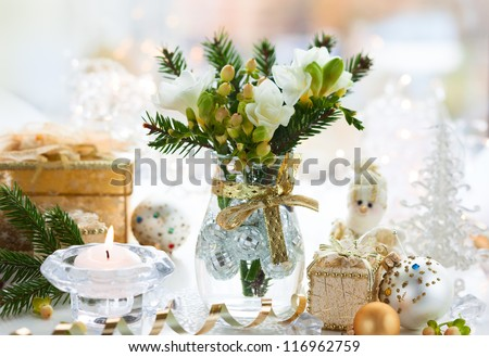 Christmas table decoration with flowers,gifts and baubles