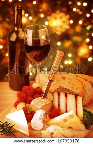 Christmas table, festive food still life, romantic cheese and wine set up, Xmas party at home  - stock photo