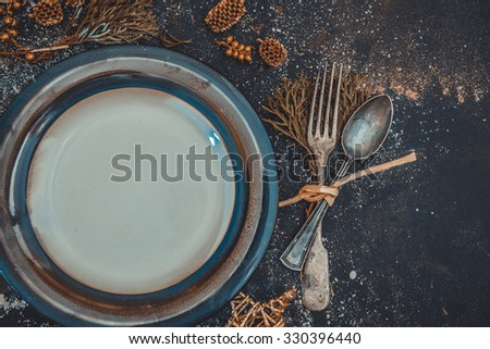 Christmas Table layout. Beautifully decorated with antique tools and plate - stock photo