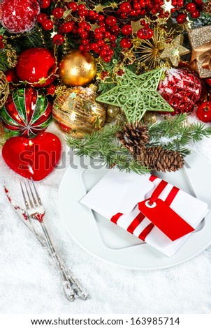 christmas table place setting decoration with red heart shaped candle. festive holidays background. candle light dinner - stock photo