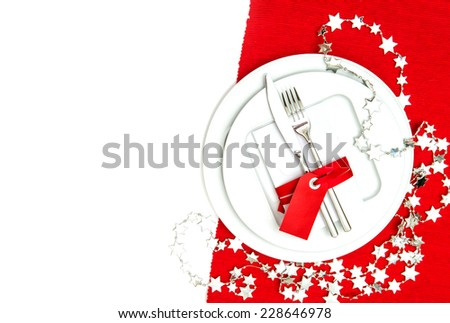 christmas table place setting decorations in red and silver. holidays background with place for your text - stock photo