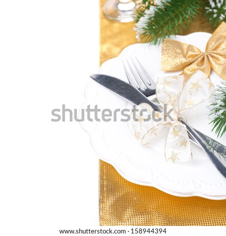 Christmas table place setting, isolated on white background - stock photo
