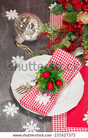 Christmas table place setting with Christmas decorations. Christmas dinner vintage concept. Macro selective focus