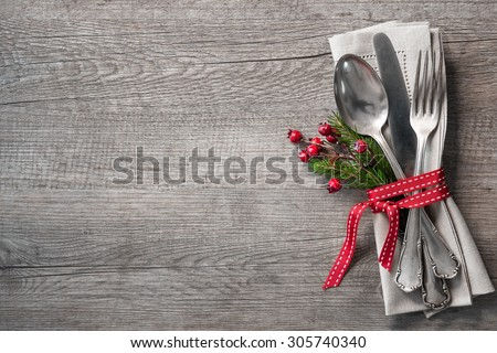 Christmas table place setting with christmas pine branches,ribbon and bow. Christmas holidays background - stock photo