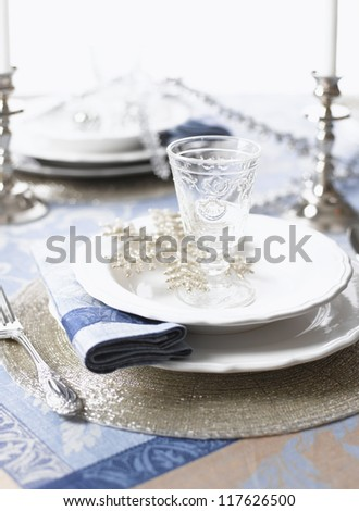 Christmas table set for holiday dinner party. (shallow DOF) - stock photo