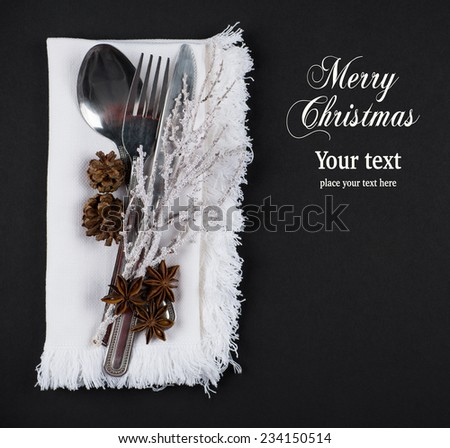 Christmas table setting, christmas menu concept in silver, brown and white color tone on dark grey background with copy text space - stock photo