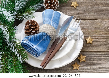 Christmas table setting on a wooden background, horizontal, top view - stock photo
