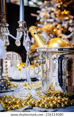 Christmas table setting with champagne and candles - stock photo