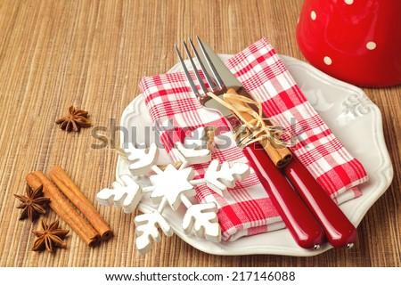 Christmas table setting with christmas decorations - stock photo