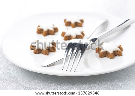 Christmas table setting with cookies, selective focus - stock photo
