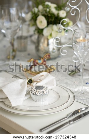 christmas table setting with cupcakes - stock photo