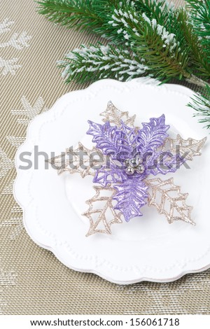 Christmas table setting with fir branches - stock photo