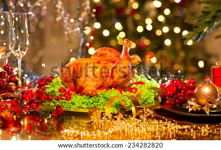 Christmas table setting with turkey. Christmas dinner. Holiday decorated table, Christmas tree, champagne and roasted turkey, Christmas served table  - stock photo