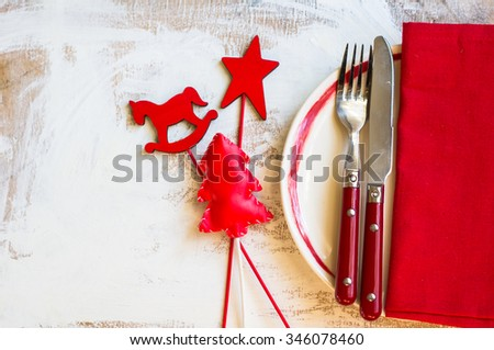 Christmas table setting with vintage silverware and christmas decoration on rustic wooden table - stock photo
