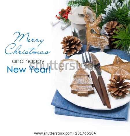 Christmas table setting with wooden decorations over white, close-up - stock photo