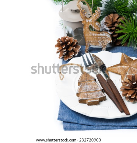 Christmas table setting with wooden decorations over white, selective focus, top view - stock photo