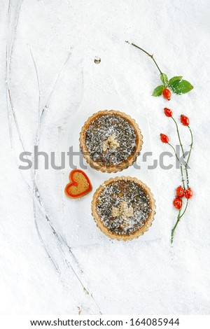 christmas  tart with mincemeat and candied peel on white snow festive background - stock photo