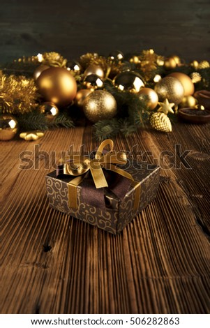 Christmas theme. Presents on a wooden table. Golden and brownish aesthetics.