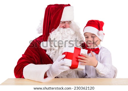 Christmas theme: Santa Claus and child having a fun. Isolated over white background - stock photo