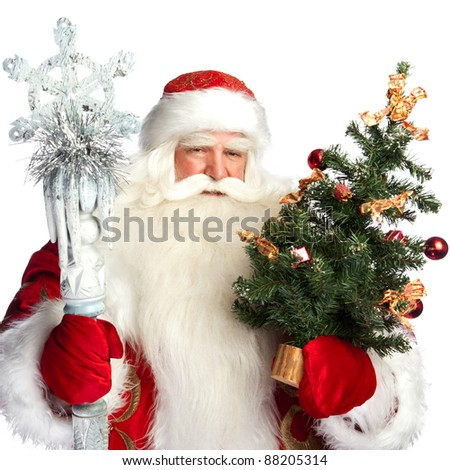 Christmas theme: Santa Claus holding christmas tree? staff and his bag full of gifts over white background