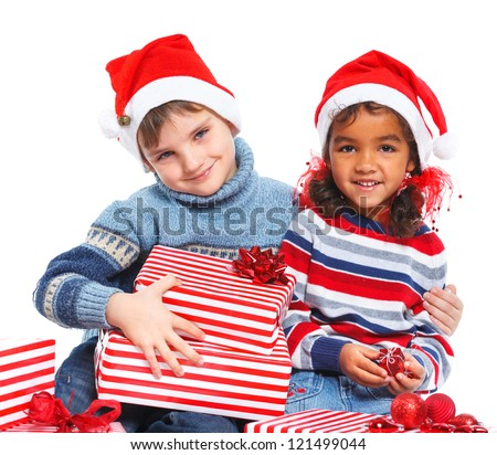 Christmas theme - Smiling little mullato girl and her brother in Santa's hat with gift box, isolated on white - stock photo