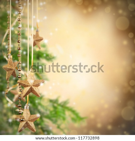 Christmas theme with golden glass stars and free space for text - stock photo