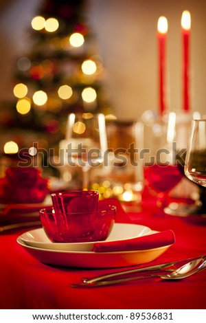 Christmas themed dinner table in the kitchen - stock photo