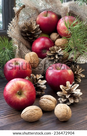 Christmas time composition with walnuts and fruits