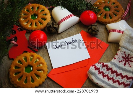 Christmas time decoration, cookies, cinnamon, anise star, lamp and letter to Santa - stock photo