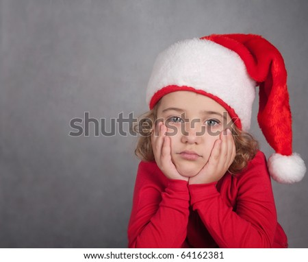 Christmas time - girl with Santa Claus Hat - stock photo