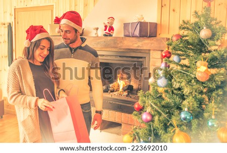christmas time. happy couple sharing presents - stock photo