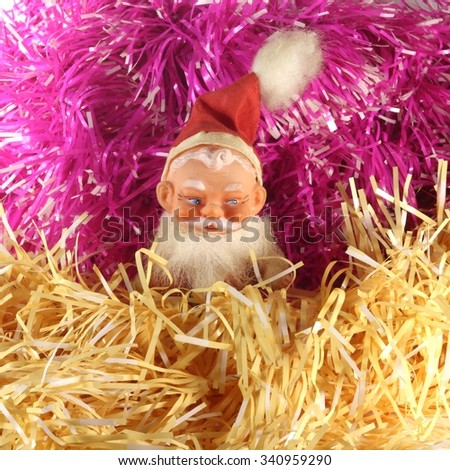 Christmas tinsel and the dwarf from the fairy tale. 1 - stock photo