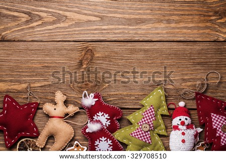 Christmas toy on a wooden table with space for text, top view - stock photo