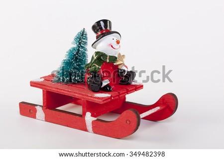 Christmas toy Santa Claus - a Snowman on a white background - stock photo