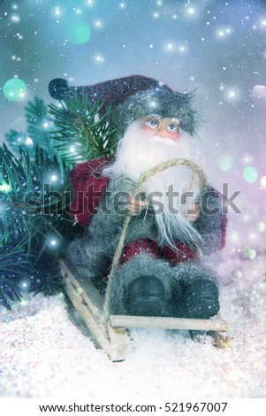 Christmas toy Santa Claus in a sleigh.