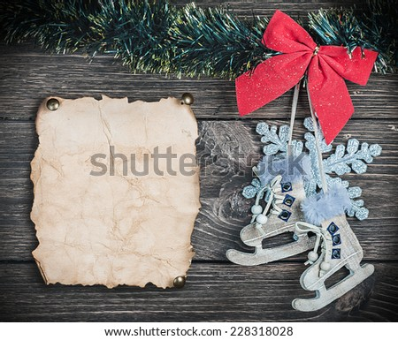 Christmas toys and old Paper the on wooden background - stock photo