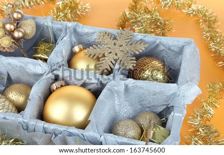 Christmas toys in wooden box on yellow background