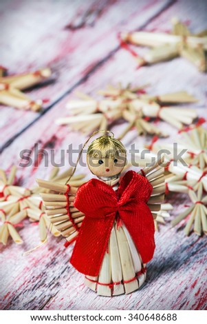 Christmas toys of straw on wooden table
