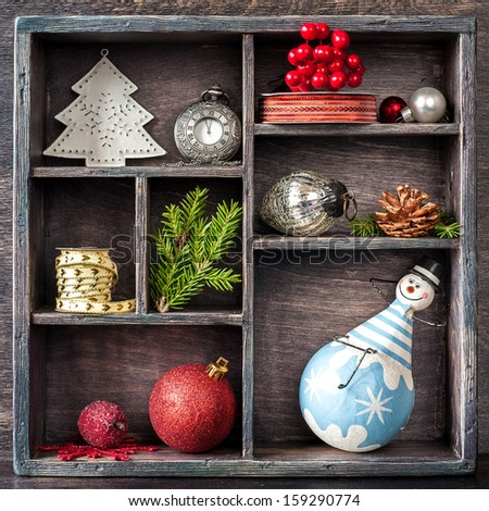 Christmas tray with toys. Antique clock, snowman and balls - stock photo