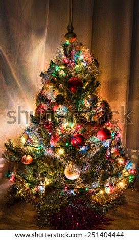 Snow Covered Christmas Tree Multi Colored Stock Photo