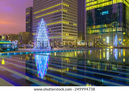 Christmas tree among the skyscrapers in Paris, France - stock photo