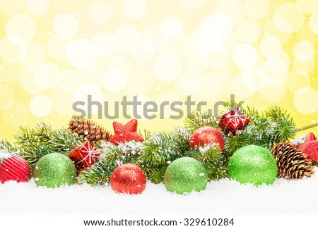 Christmas tree and bauble decor on snow with bokeh background for copy space - stock photo