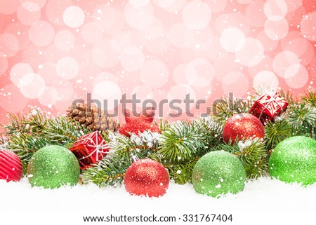 Christmas tree and bauble decor on snow with bokeh background for copy space