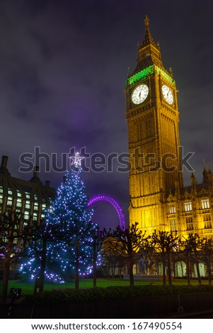 Christmas Tree and Big Ben in London, England, December 2013 - stock photo