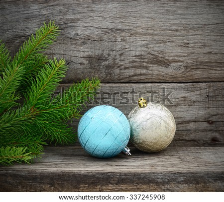 Christmas Tree and christmas balls on wooden background - stock photo