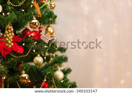 Christmas tree and Christmas decorations on background of de-focused lights