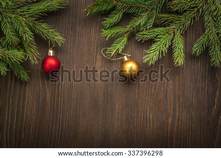 Christmas Tree and decorations on wooden background space for lettering - stock photo