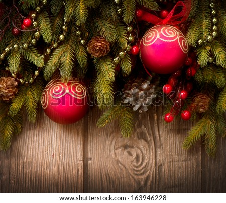 Christmas Tree and Decorations Over Wooden Background. New Year Baubles over Wood  - stock photo