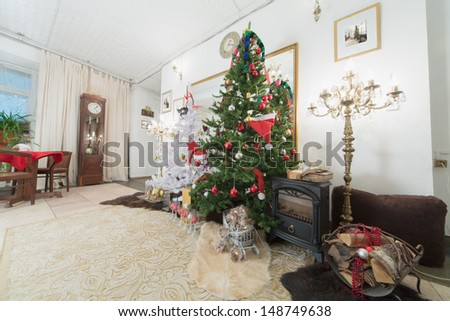 Christmas tree and fireplace in the living room decorated for the new year - stock photo