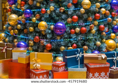 Christmas tree and gift box background - stock photo